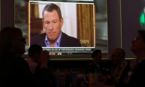 A video screen at a hotel restaurant in Grapevine, Texas, Friday, shows Lance Armstrong being interviewed by Oprah Winfrey.