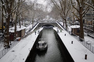 Paris snow: Snow covers paths alongside the Canal Saint-Martin