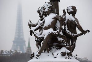 Paris snow: Snow blankets statues on the Alexander III bridge