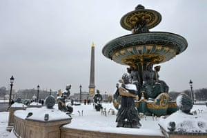 Paris snow: A snow-covered fountain at the Place de