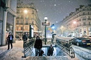 Paris snow: People leaving a Metro station in Paris under heavy snowfall
