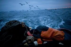 FTA: Rodrigo Abd: Fisherman Walter Richardi naps on the sternd