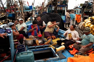 FTA: Rodrigo Abd: Fishermen eat lunch in the bow of a fishing boat