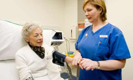 Elderly patient receiving care from a nurse.