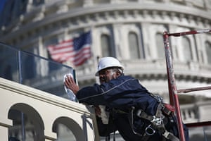 24 hours: Washington, DC , US:  A worker cleans bulletproof glass