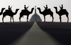 24 hours: New Delhi, India: Border Security Force soldiers ride their camels