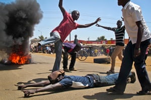 24 hours: Kisumu in western Kenya: Protesters block a road with burning tyres