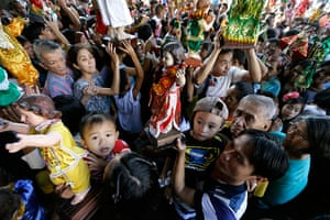 24 hours: Manila, Philippines: Hundreds of Roman Catholic devotees