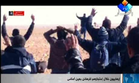A group of people believed to be hostages kneel in the sand with their hands in the air at an unknown location in Algeria. David Cameron is making a statement on the hostage crisis in the Commons this afternoon.