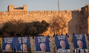 "Likud party activists hang campaign posters of Israeli PM Binyamin Netanyahu that read: ""Only Netanyahu will guard Jerusalem."""