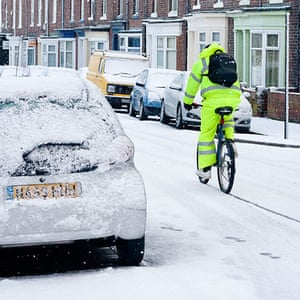 readers snow pix: A man cycles through the snow on December 05, 2012, in Sunderland, England