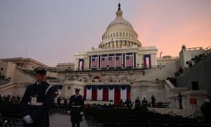 A member of the military stands guard at sun rise before the presidential inauguration in front of the U.S. Capitol in Washington, DC.