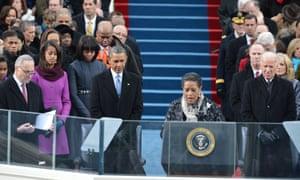 Barack Obama listens to the invocation by Myrlie Evers-Williams