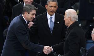 Poet Richard Blanco (left) is greeted by Joe Biden Barack Obama