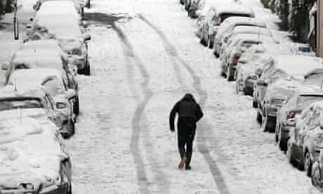 Parked cars in snowy Bath