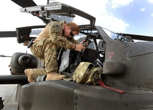 Harry in Afghanistan: Prince Harry with a helicopter