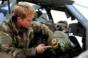 Harry in Afghanistan: Prince Harry with his helmet and badges