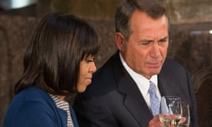 Michelle Obama clinks glasses with House Speaker John Boehner during the inaugural lunch.