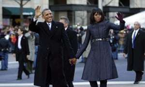 President Obama and Michelle Obama walk down Pennsylvania Avenue during the 57th Presidential Inauguration parade.