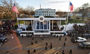 Barack Obama walks down Pennsylvania Avenue to the White House during the inaugural parade.