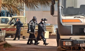 Algerian firemen carry a coffin containing the body of a hostage killed during the crisis at the remote In Amenas gas plant