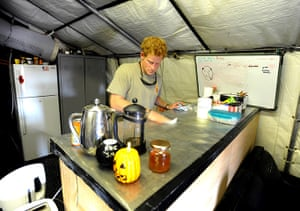 Prince Harry Afghanistan: Prince Harry cleans the kitchen work surface