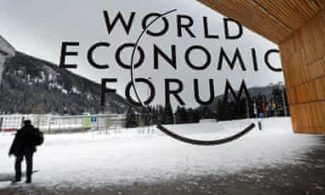 As the cold winds of the recession blow around Europe a man walks outside the main entrance of the Davos congress centre, on the eve of the opening of the 43rd Annual Meeting of the World Economic Forum, WEF, in Switzerland.