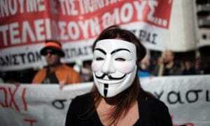 A protester marches during an anti-austerity protest in Athens, Greece.