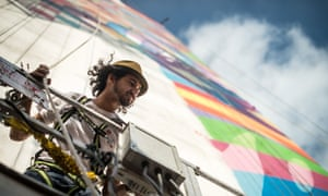 Brazilian mural artist Eduardo Kobra paints the side of a 56-meter high building, portraying Brazilian architect Oscar Niemeyer along Paulista avenue in Sao Paulo, Brazil.
