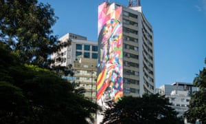 Wide shot of Brazilian mural artist Eduardo Kobra and his assistants as they paint the side of a building in Sao Paulo, Brazil. Photograph: Yasuyoshi Chiba/AFP/Getty Images