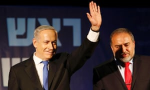 Israel's Prime Minister Benjamin Netanyahu waves to supporters as he stands next to former foreign minister Avigdor Lieberman at the Likud party headquarters in Tel Aviv. Hawkish Prime Minister Netanyahu emerged the bruised winner of Israel's election, claiming victory despite unexpected losses to resurgent centre-left challengers.