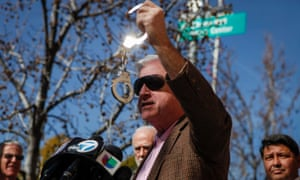 Jim Robertson, a child sex abuse victim, holds up a pair of handcuffs while speaking during a news conference with other victims and supporters of the Survivors Network of those Abused by Priests (SNAP) in Los Angeles, California. The Los Angeles Times reported that former Los Angeles Archbishop Cardinal Roger Mahony and his top adviser on child sex abuse cases, Monsignor Thomas Curry, worked with other church officials in 1987 to send priests accused of abuse out of state to avoid prosecution.