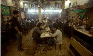 Iranians in Tehran coffee shop