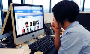 woman looking at Facebook in office