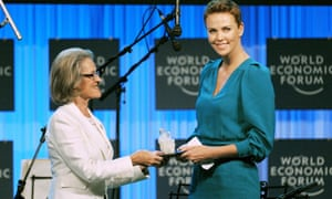 Charlize Theron receives a World Economic Forum Crystal award from Hilde Schwab, Chairperson and Co-Founder of the Schwab Foundation for Social Entrepreneurship. AFP PHOTO  ERIC PIERMONTERIC PIERMONT/AFP/Getty Images