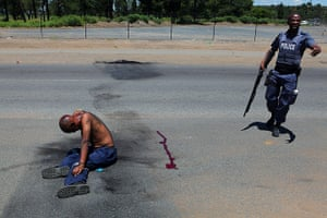 24 hours: Sasolburg, South Africa: A protester lies injured by police
