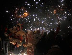 24 hours: Palma de Mallorca, Mallorca: Revellers dance under fireworks