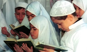 Muslim children read verses from the Qu'ran