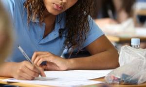 A school pupil sits a GCSE English exam