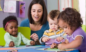 A teacher and toddlers in a nursery