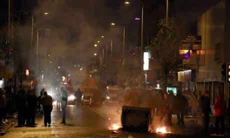 Burning debris blocks a road in east Belfast