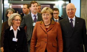 Klaus Schwab (on the right), founder of the World Economic Forum and his wife Hilde welcome German Chancellor Angela Merkel to Davos.