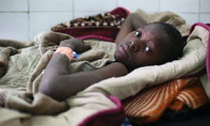 Thirteen-year-old Manjou Cisse, who was wounded by shrapnel during clashes between forces in Diabaly, looks on from his bed at Nianakoro Fomba hospital in Segou, Mali. Diabaly has now been liberated from rebels by French and Mali troops.