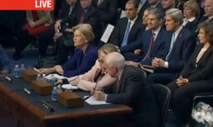 John Kerry seated next to his wife, Teresa Heinz. Sens. Warren and McCain flank Clinton at the witness' table in a screen grab from CNN.