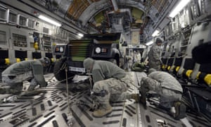 US soldiers secure a French armored vehicle aboard a C17 aircraft at the Istres military airport prior to take off bound for Mali. French forces are continuing their advance northwards in Mali with over 2,000 troops assisting Malian forces fight islamic militants. Read our latest report. Photograph: Gerard Julien/AFP/Getty Images