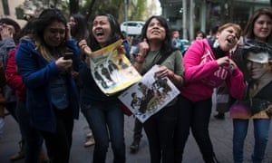 Excited fans of US musicians The Jonas Brothers gather outside the W Hotel where the artists were attended a press conference in Mexico City.