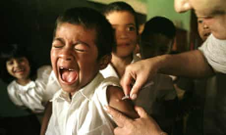Cristino Lopez, 7, is given a vaccination shot for tuberculosis in Tegucigalpa, Honduras