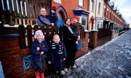 Lorna and Stuart Holden with their four children outside their house in Hartlepool