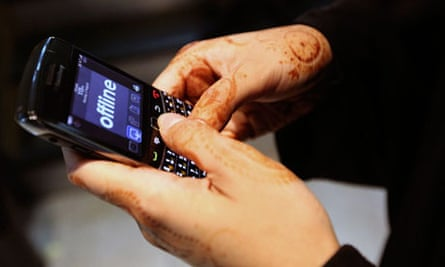 A woman uses her BlackBerry phone