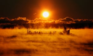 A barge makes an eery journey through arctic sea-fog on its way out of Portland Harbor, in Maine, USA, where the temperature at sunrise was about five degrees below zero. Brrr... Photograph: Robert F Bukaty/AP